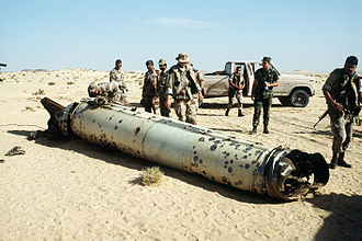 Scud - Military personnel examine the remains of a Scud during the Gulf War, 26 May 1992