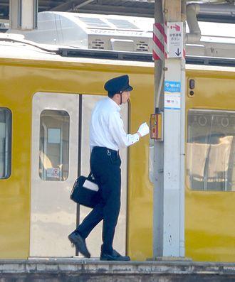 Seibu Shinjuku Line - A Seibu Railway train driver at Kami-Shakujii Station in May 2015