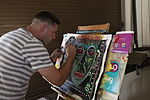 Sergeant therapeutically paints through PTSD healing process 120403-M-OT671-010.jpg