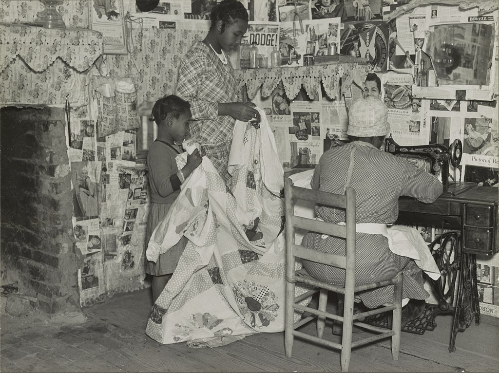 Sewing a quilt. Gees Bend, Alabama - April 1937