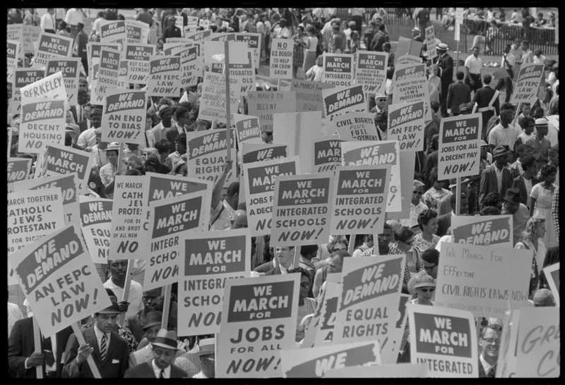File:Signs carried by many marchers 37245u.tif