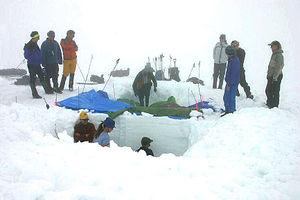 Snowpack - Digging a snowpit on Taku Glacier, in Alaska to measure snowpack depth and density