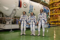 Soyuz TMA-11M crew during the 'fit check'.jpg