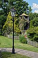 Street lamp ornament and gloriette with climbing rose at Boreham, Essex, England.jpg