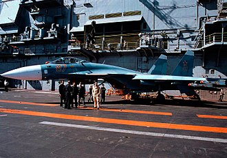 Russian Navy - A Sukhoi Su-33 from the 279th Shipborne Fighter Aviation Regiment, on Admiral Kuznetsovs flight deck.