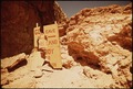 THE BROKEN SIGN IS AN EXAMPLE OF DAMAGE BY TOURISTS IN THE REMOTE HAVASUPAI INDIAN COUNTRY - NARA - 544297.tif