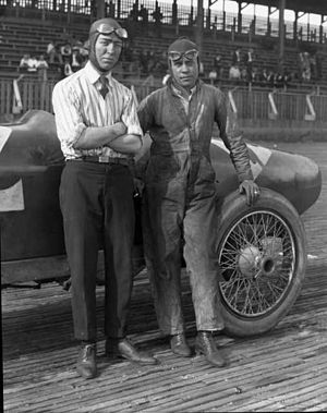 Riding mechanic - 1922 Indianapolis 500 winner Jimmy Murphy is shown here with his riding 'mechanician' Eddie Olson, posing next to their Duesenberg at Tacoma Speedway.