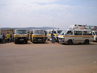 A row of minibus share taxis waiting to depart  in Kigali, Rwanda.