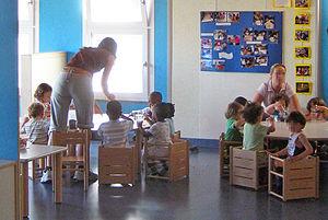 Reggio Emilia approach - Teachers and children in an italian nursery school