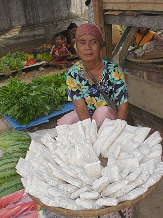 Tempeh - Tempe being sold in a traditional market in Indonesia
