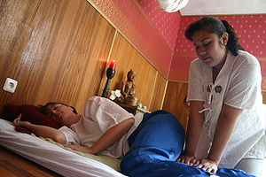 Nuat phaen boran or Thai massage, side-lying p...