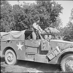 """George Philip Bradley Roberts - Major General """"Pip"""" Roberts, GOC 11th Armoured Division, in his White scout car, August 1944."""