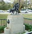 The Man with the Donkey statue oblique view.jpg