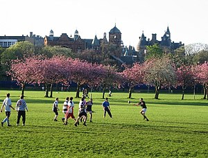 The Meadows (park) - People playing rugby in the spring