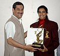 The Minister of State (Independent Charge) for Youth Affairs & Sports, Shri Jitendra Singh presenting the Arjuna Award 2013 to Ms. P.V. Sindhu, Badminton player, in New Delhi on September 24, 2013 (1).jpg