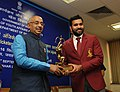 The Minister of State for Youth Affairs and Sports (IC), Water Resources, River Development and Ganga Rejuvenation, Shri Vijay Goel conferring the Arjuna Award on Cricketer Rohit Sharma, in New Delhi on September 16, 2016.jpg