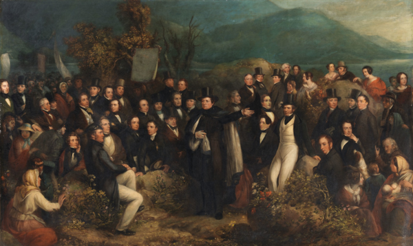 The Monster Meeting at Clifden in 1843 by Joseph Patrick Haverty. Daniel O'Connell is depicted in the center addressing the gathered masses. The Monster Meeting at Clifden in 1843.png
