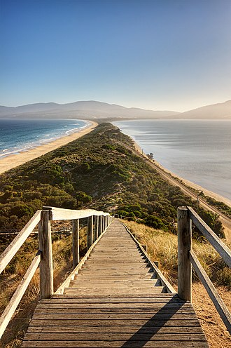 "Isthmus - The sandy isthmus or tombolo ""The Neck"" connecting North and South Bruny Island in Tasmania, Australia"