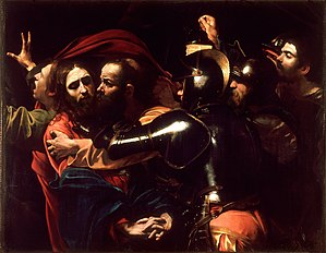 Judas kisses Jesus, and soldiers rush to seize the latter.