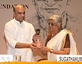 The Union Minister for Human Resource Development, Dr. M.M. Pallam Raju presenting the Saraswati Samman 2012 to the Smt. Sugathakumari, at a function, instituted by the K.K. Birla Foundation, in New Delhi on August 02, 2013.jpg