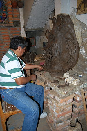 Soteno family - Tiburcio Soteno working on a sculpture in his workshop