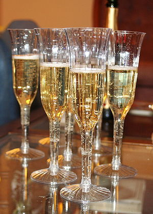Glasses of champagne await use to toast the ar...