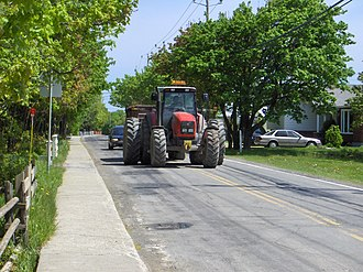 Traffic bottleneck - A slow tractor creates a moving bottleneck.