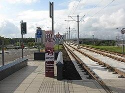 Tramway crossing railway (geograph 3698936).jpg