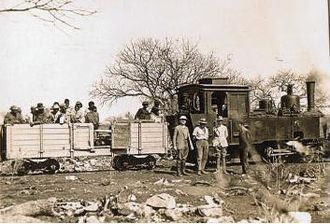 Otavi Mining and Railway Company - OMEG tank locomotive with high-side gondola near Tsumeb about 1931.