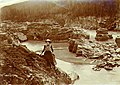 Two lady excursionists, Miss Cummings (left) and Miss Pratt (right) on the bank of the Stewart River at Fraser Falls, Yukon (MEED 120).jpg