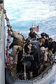 U.S. Coast Guard Lt. Aaron Renschler, team leader of Tactical Law Enforcement Detachment 406, loads a rigid-hull inflatable boat with members of the visit, board, search and seizure team, currently embarked 100524-N-EF447-003.jpg