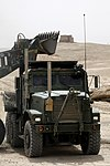 U.S. Marine Corps Lance Cpl. Wesley J. Henkel, a motor transport operator with Marine Wing Support Squadron (MWSS) 271, drives a medium tactical vehicle replacement at Camp Bastion, Helmand province 130807-M-SA716-114.jpg