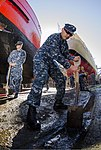 U.S. Navy Aviation Machinist's Mate 1st Class Raymond Salenga, assigned to the aircraft carrier USS George Washington (CVN 73), shovels mud and debris during a community service project as part of Talisman Saber 130731-N-BD107-060.jpg