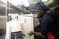 U.S. Navy Culinary Specialist Seaman Godfred Osei prepares dough in the galley aboard the aircraft carrier USS George H.W. Bush (CVN 77) in the Atlantic Ocean May 21, 2013 130521-N-CZ979-020.jpg
