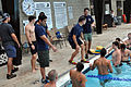 U.S. Navy Gunner's Mate 2nd Class Conner Mastry, Aviation Structural Mechanic 2nd Class Jacob Alvarado and retired Master Chief Marc Presson, a former SEAL, give instructions prior to a timed swim in a physical 130813-N-MY805-004.jpg