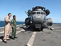 U.S. Navy Lt. Cmdr. Scott Tompkins, left, with Helicopter Mine Countermeasures Squadron (HM) 15, shares MH-53E Sea Dragon helicopter mine hunting tactics with Japan Maritime Self-Defense Force pilot Lt. Takashi 130518-N-YY107-027.jpg