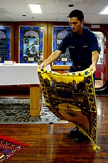 U.S. Navy Personnel Specialist Seaman Brandon Guillen lays out Islamic prayer rugs in the chapel of the aircraft carrier USS Ronald Reagan (CVN 76) in the Pacific Ocean Nov. 5, 2013 131105-N-TO979-001.jpg