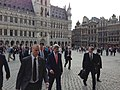 U.S. Secretary of State John Kerry and senior staff walk through the Grand Place in Brussels, Belgium. April 22, 2013.jpg