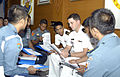 U.S. and Indonesian naval officers discuss a simulation during a legal training symposium in Jakarta, Indonesia, Aug. 24, 2009 090824-N-WL717-087.jpg