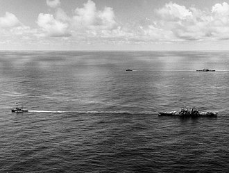 Formosa Air Battle - Image: USS Canberra (CA 70) and USS Houston (CL 81) under tow on 18 October 1944, after receiving torpedo hits (NH 98343)