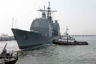 USS Ticonderoga (CG-47) - Ticonderoga is towed from Naval Station Pascagoula immediately following her decommissioning on 30 September 2004.