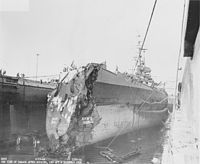 USS Washington in drydock at Pearl Harbor showing collision damage
