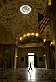 US Navy 031009-N-9693M-019 A lone Midshipman walks through the rotunda of Bancroft hall at the U.S. Naval Academy.jpg