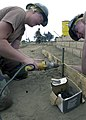 US Navy 040408-N-8977L-005 Steelworker 3rd Class Kacie Fehling, of Reno, Nev., sets up a concrete mold to help form a sidewalk.jpg