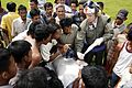 US Navy 050109-N-4166B-157 Hospital Corpsman 3rd Class Joseph Budke of Aurora, Colo., explains to local Indonesian citizens in Tjalang, Sumatra, Indonesia, an illustration that helps communicate the dangers of a helicopter,.jpg