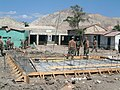 US Navy 050225-N-3322M-001 Seabees assigned to Naval Mobile Construction Battalion One (NMCB-1), begin pouring the foundation for a three-room schoolhouse at La Nativite School in Gonaives, Haiti.jpg