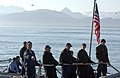 US Navy 050812-F-7169B-005 Linehandlers stationed aboard the guided missile frigate USS Crommelin (FFG 37) pull slack in from the mooring lines as the ship pulls into Alaska for a port visit prior to participating in Northern.jpg