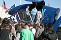 US Navy 060313-N-3271W-006 Agua Fria High School students stand in line to experience the Navy's Blue Angels F-A-18 flight simulator.jpg