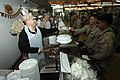 US Navy 061123-N-3642E-003 Secretary of the Navy (SECNAV) The Honorable Dr. Donald C. Winter serves Thanksgiving lunch to Marines and Sailors stationed at Camp Fallujah.jpg