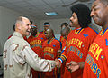 US Navy 061208-N-1328C-241 Combined Joint Task Force-Horn of Africa Commander, Rear Adm. Richard Hunt, meets with the Harlem Globetrotters, prior to their performance at Camp Lemonier, home of the Combined Joint Task Force-Horn.jpg
